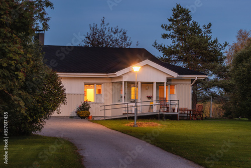 Fototapeta Typical Finnish style countryside house at night. obraz