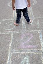 Child, Blond Boy, Playing Hopscotch On The Street