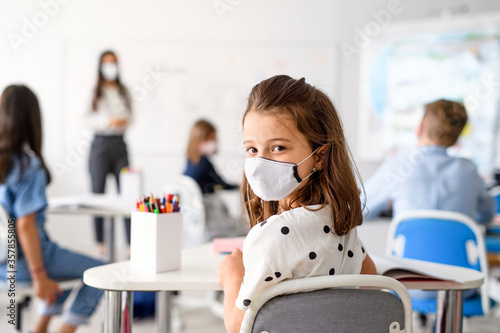 Fotografie, Tablou Child with face mask back at school after covid-19 quarantine and lockdown