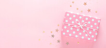 Gift Box On A Delicate Pink Ba...