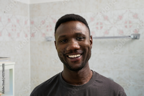 Carta da parati Young Black Man with Toothy Smile Looking at Camera