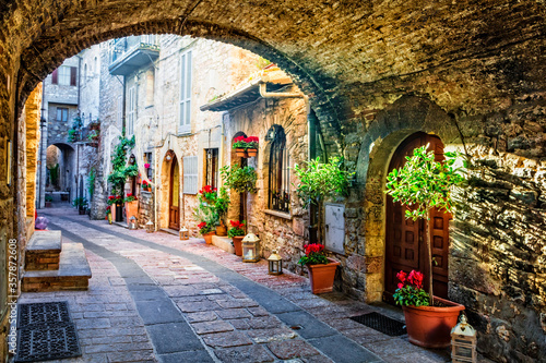 Fototapety, obrazy: Charming old medieval villages of Italy with typical floral narrow streets. Assisi , Umbria
