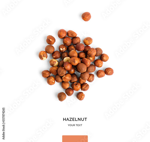Fotografía Creative layout made of hazelnut nuts on white background