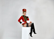 Beautiful Girl In An Old Hussar Costume And In Black Boots And With A Gun