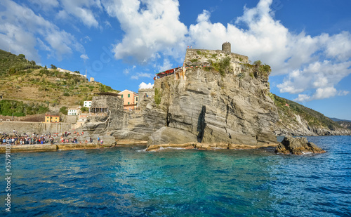 Fototapeta The Castello Doria, the ancient fort along the Ligurian Coast is visible from the sea at the fishing village of Vernazza, Italy, part of the Cinque Terre