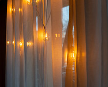 Coffeeshop Lights Agains A Whi...
