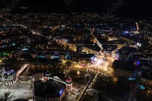 Fototapeta Aerial view above the city of Skopje at night obraz na płótnie