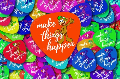 Photo Colorful batches with monkies and [MAKE THINGS HAPPEN] written on them - concept