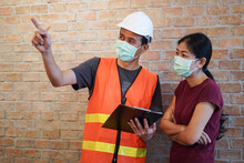 Worker Or Inspector In Protective Mark Discuss With Customer And Inspect Advice By Checklist And Pointing In The Building As New Normal Covid-19