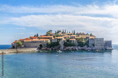 Photo Famous Sveti Stefan (now Aman Sveti Stefan) - small islet and Luxury hotel resort in Montenegro, approximately 6 kilometers southeast of Budva