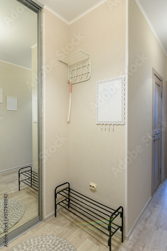 Entrance hall with built-in closet in the interior of the apartment Tablou Canvas