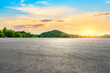 canvas print picture - Empty asphalt road and green mountain landscape at sunset.
