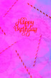 canvas print picture - Happy birthday letters with festive straws on marble background with neon pink creative toning. Futuristic party and celebration concept. Top view. Vertical