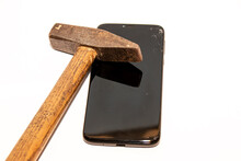 Broken Glass Mobile Phone With A Hammer, White Background