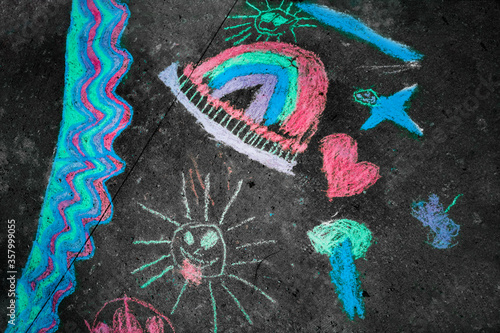 Children chalk drawing on street for summer vacation sun rainbow for covid-19 cancelled holidays staycation. #357999055