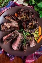 Slices Of Beef Steak Served Wi...