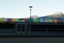 Blurred Moving Regional Colorful Train In Meran City