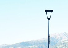 Street Lamp With Mountains And...