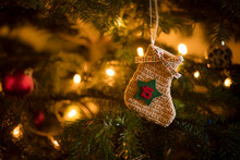 Traditional Advent Calendar Stocking With The Date Of The 15th Of December Hanging On A Traditional Christmas Tree.