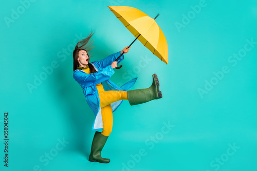 Full length profile photo of shocked lady stormy rainy weather walk street hold Canvas Print