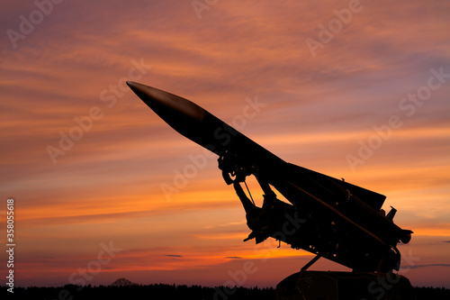 silhouette of an air defense missile against the background of dawn Canvas Print