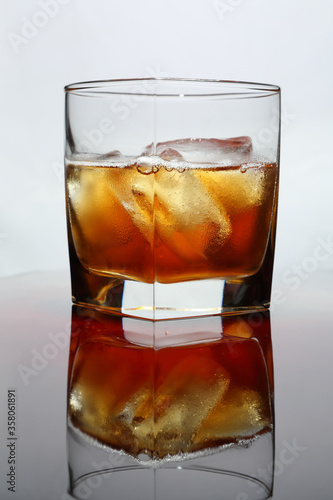 Whiskey with ice on a light background Canvas Print