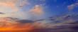 Leinwandbild Motiv Colorful dramatic sky with big clouds and sunset