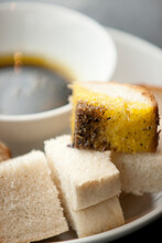 Balsamic Vinegar And Olive Oil In A Bowl With A Mix Of White And Wholemeal Crusty Bread In A Cafe Setting