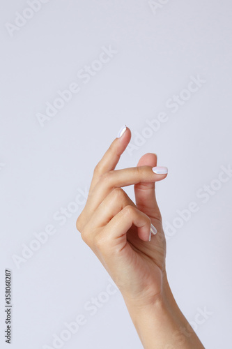 Foto Gesture and sign, female hand on a white background
