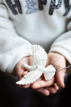 Baby Girl Is Holding Turtle Dove With Her Hands. The Turtle Dove Is Intricately Sculptured From An Artisan With Resin Material To Look Realistic Like Real Dove