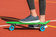 Foot Of Skateboarder Riding On Penny Board
