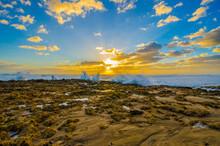 Sunbeams And Breaking Waves On...