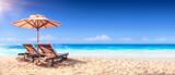 Fototapeta Fototapety z morzem do Twojej sypialni - Two Chairs And Parasol With In The Golden Beach