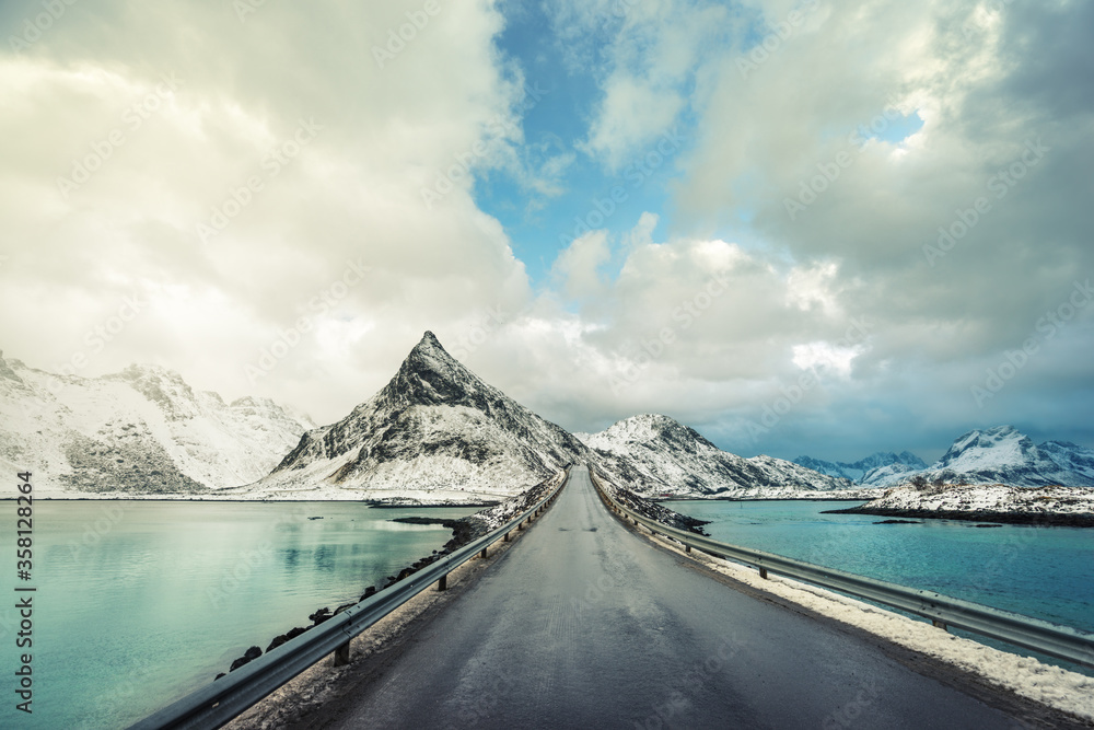 Fototapeta Olstind Mount and asphalt road. Lofoten islands, spring time, Norway