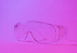 canvas print picture - Protective transparent glasses in studio neon pink light.