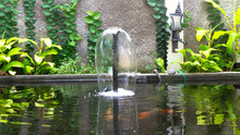 A Fountain In A Fish Pond