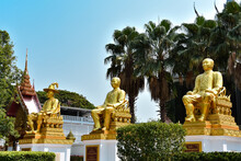 Three Golden Statues In Front ...