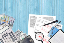 IRS Form W-2 Wage And Tax Statement Lies On Flat Lay Office Table And Ready To Fill. U.S. Internal Revenue Services Paperwork Concept. Time To Pay Taxes In United States