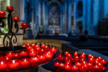 Red Votive Candles In A Church