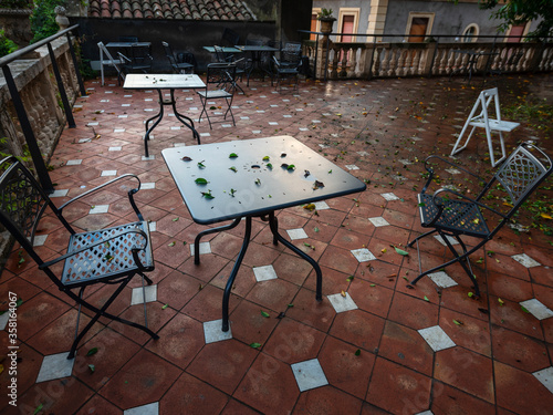 Платно Places for two on a deserted terrace in the evening in the city center