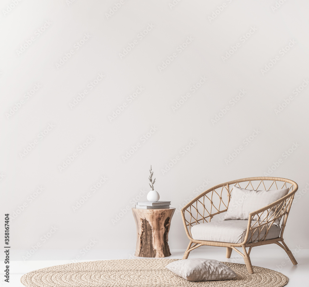 Fototapeta Mock up wall in Scandinavian living room design, home decor with rattan armchair and natural wooden table on empty bright background