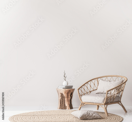 Obraz Mock up wall in Scandinavian living room design, home decor with rattan armchair and natural wooden table on empty bright background - fototapety do salonu