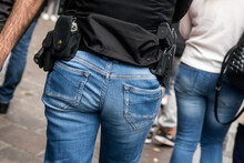 Closeup Of French Criminality Squad Police With Shotgun And Handcuffs Walking In The Street