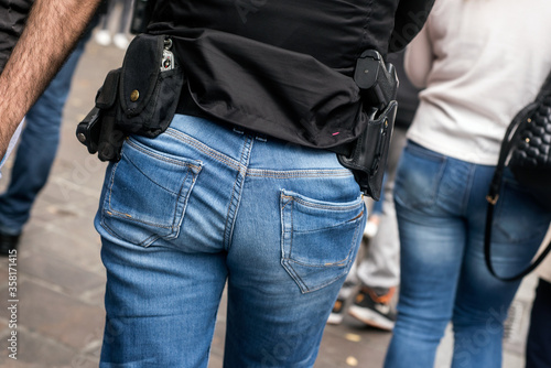 Obraz na plátne closeup of french criminality squad police with shotgun and handcuffs walking in
