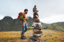 Man Hiking With Backpack Using...