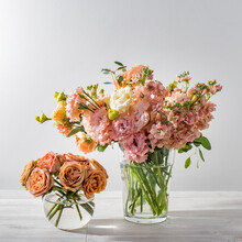 A Wedding Bouquet Of Lisianthus, Antirrhinum And Various Varieties Of Eucalyptus In A Glass Vase On The Kitchen Table.