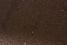 Water Drops On A Brown Metal S...