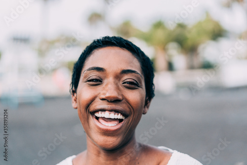 Portrait of african woman outdoor - Happy black female laughing in front of the Wallpaper Mural