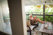 Senior Man Relaxing On Porch, ...