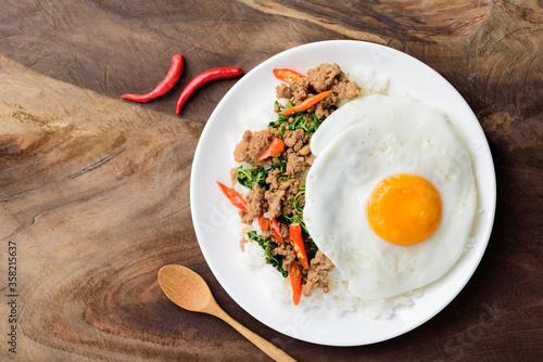Thai food, stir-fried holy basil with minced pork and fried egg (Pad Kaprao Moo Canvas Print